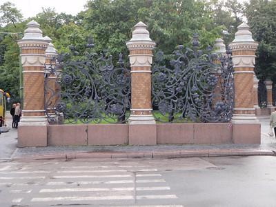 Massive ornate wrought-iron gates around the church
