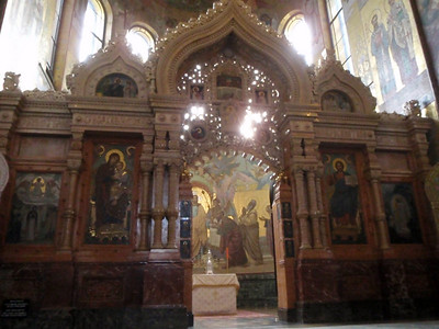 The iconostasis (a partition or screen, decorated with icons, separating the sanctuary from the rest of the church)