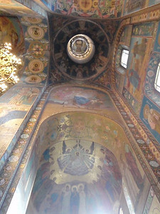 Another ceiling dome with a young boy pictured