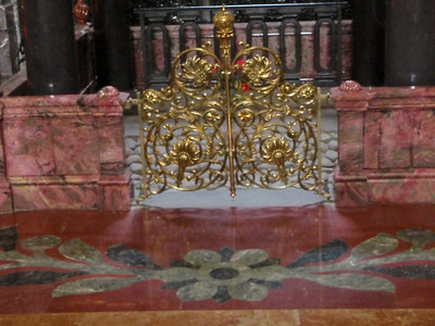 Gold gates with pink marble sides and inlaid floor