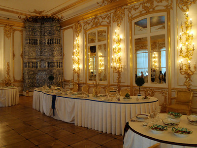 Dining Room with table decorations and dinnerware designed to match the coat of arms of visiting royalty
