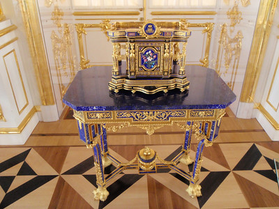 Blue lapiz and gold piece of furniture and inlaid floor