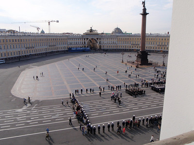View of the Palace Square from a window in the Hermitage.  A naval military ceremony was in progress.
