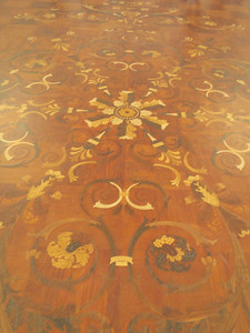 Wooden inlaid floor was designed to match the pattern in the chandelier