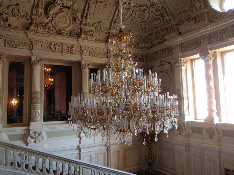Oppulent chandelier at the top of the main staircase