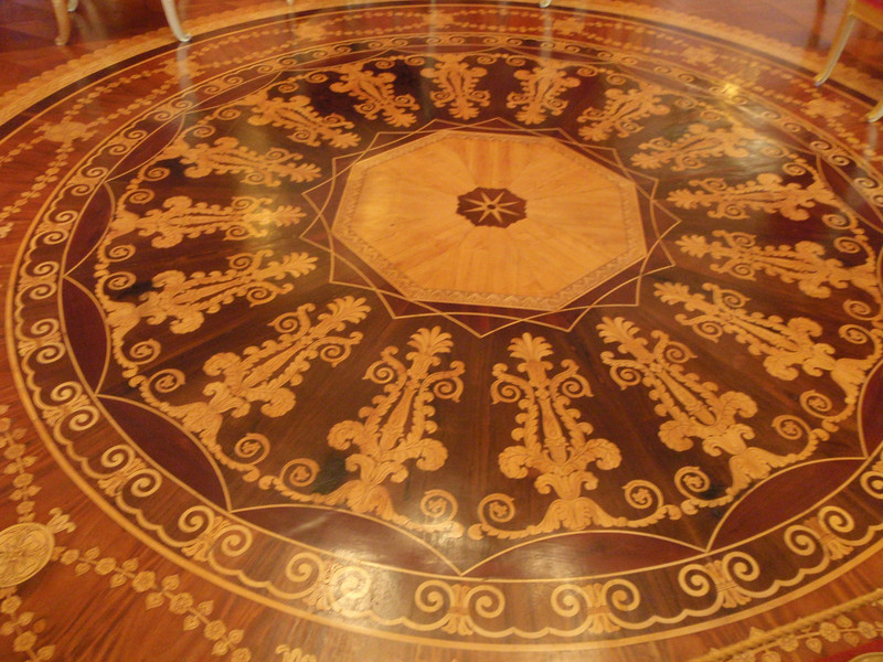 Intricate inlaid wooden flooring in the Red Room