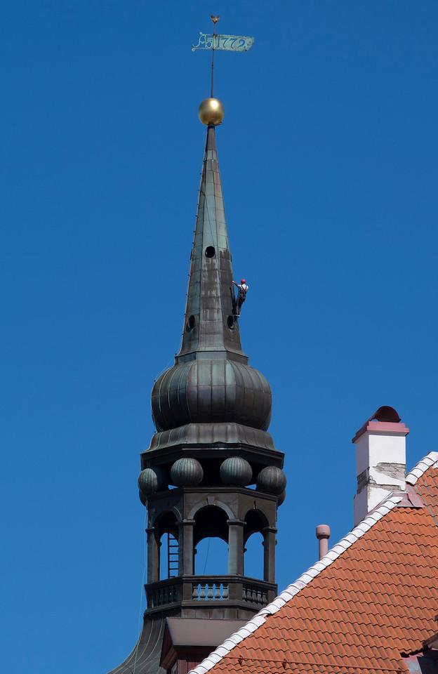 Toomkirik Church Tower and worker