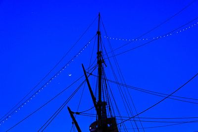 Masts and rigging of the USS Constellation at twilight, in the Inner Harbor of Baltimore, Maryland