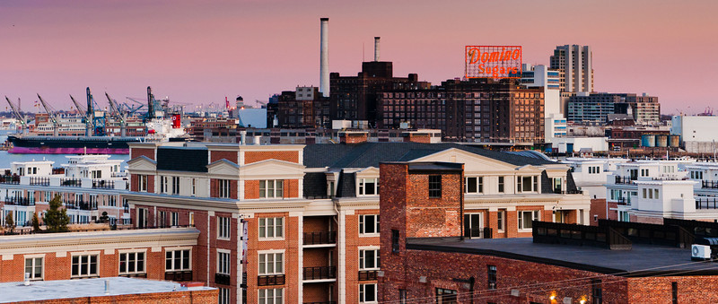 View east from Federal Hill after sunset, toward Domino Sugars, Baltimore, Maryland
