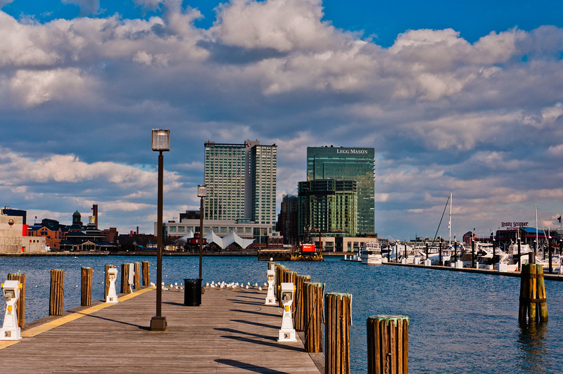 Pier and view of highrises in the Inner Harbor of Baltimore, Maryland.