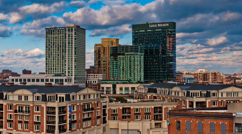 View of apartment buildings and highrises from Federal Hill Park, in Baltimore, Maryland.