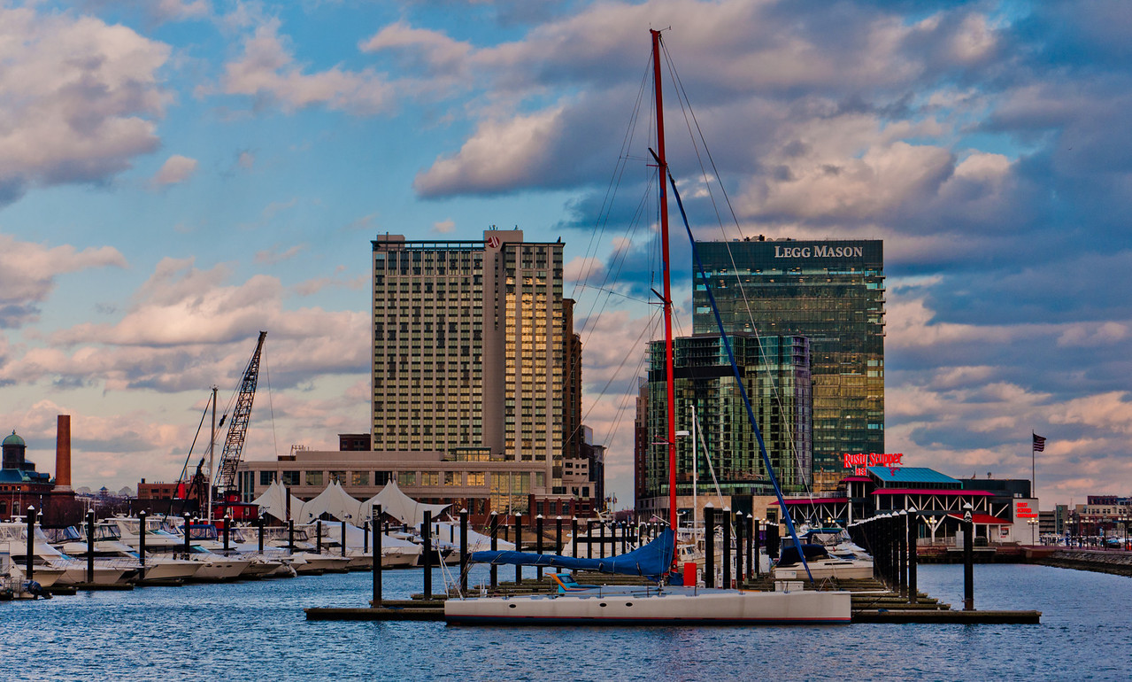 Boats and highrises in the Inner Harbor of Baltimore, Maryland.