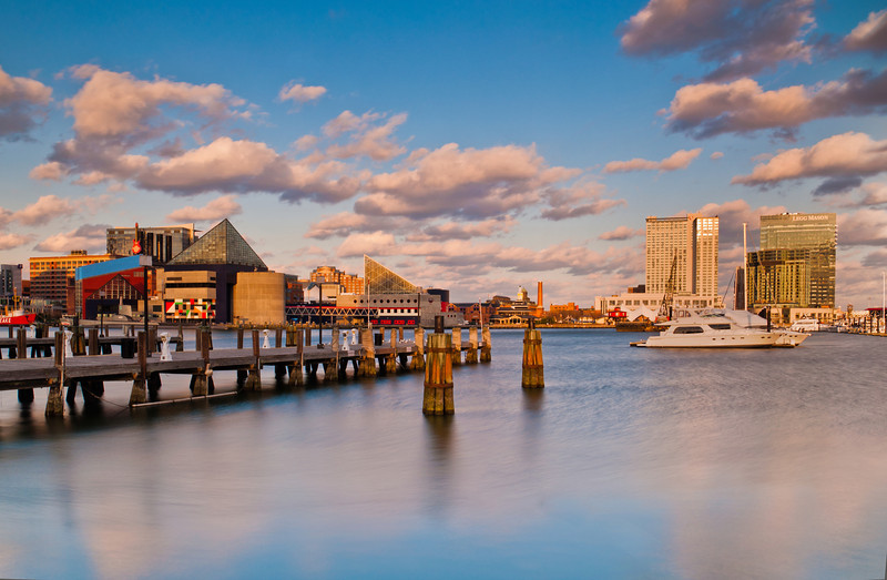 Evening view of a dock and buildings in the Inner Harbor of Baltimore, Maryland.