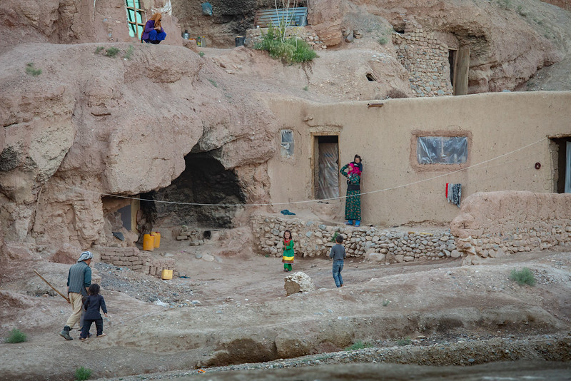 A family living in one of the the small caves near the Buddha caves of Bamyan.