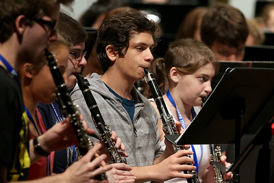 More than 100 middle and high school students from across the Northeast are exploreing their musical talents during the 20th annual Mary Jo Leahey Symphonic Band Camp at UMass Lowell this Summer.  They will have a performance at the university on July 23, 2016. A few locals from around Lowell area are participating in the camp. Playing the clarinet with the band at Friday's practice is Valentino Nicoletta from Chlmsford. SUN/JOHN LOVE