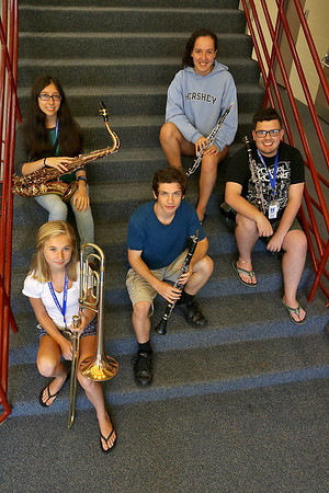 More than 100 middle and high school students from across the Northeast are exploreing their musical talents during the 20th annual Mary Jo Leahey Symphonic Band Camp at UMass Lowell this Summer.  They will have a performance at the university on July 23, 2016. A few locals from around Lowell area are participating in the camp. Clockwise from the top is Joyce Downey from Westford playing the oboe, Mark Deveau, in glasses, playing the clarinet, Valentino Nicoletta from Chelmsford playing the clarinet, Emily kleiner from Hudson NH playing he trombone and Samantha Richards from Lowell playing the tenor Saxophone. SUN/JOHN LOVE
