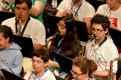 More than 100 middle and high school students from across the Northeast are exploreing their musical talents during the 20th annual Mary Jo Leahey Symphonic Band Camp at UMass Lowell this Summer.  They will have a performance at the university on July 23, 2016. A few locals from around Lowell area are participating in the camp. Playing the tenor saxophone with the band at Friday's practice is Samantha Richards, center, from Lowell. SUN/JOHN LOVE