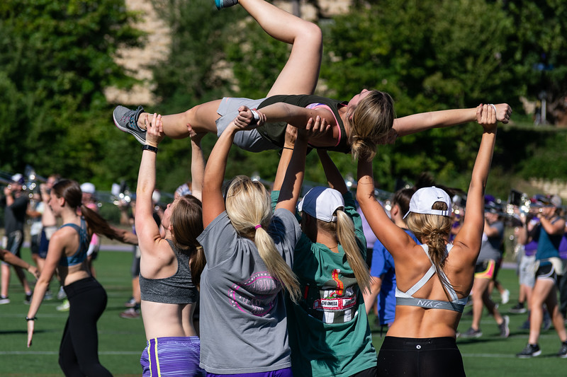 The Classy Cats perfect their dances in tune with the band at a Thursday afternoon practice on September 27th, 2018. This duo will perform at the halftime show at the Kansas State vs. University of Texas game on Saturday, September 29th. (Brooke Barrett   Collegian Media Group)