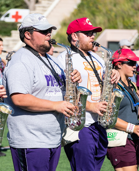 """The Kansas State Marching Band prepares their routine of """"The Greatest Showman"""" before the Saturday football game against the University of Texas. They 350+ band members will perform their routine during the halftime show. (Brooke Barrett   Collegian Media Group)"""