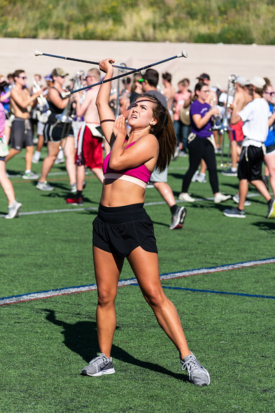A baton twirler perfects her routine in tune with the band on Thursday afternoon at Memorial Stadium on September 27th. This duo will perform at the halftime show at the Kansas State vs. University of Texas game on Saturday, September 29th. (Brooke Barrett   Collegian Media Group)