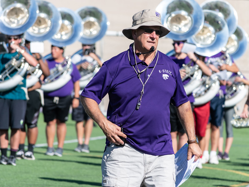 Band director, Frank Tracz, gives feedback and encouragement to the band at practice on Thursday, September 27th. The band practices at Memorial Stadium on Tuesday, Thursday, and Fridays from 2:30-5:20. (Brooke Barrett   Collegian Media Group)