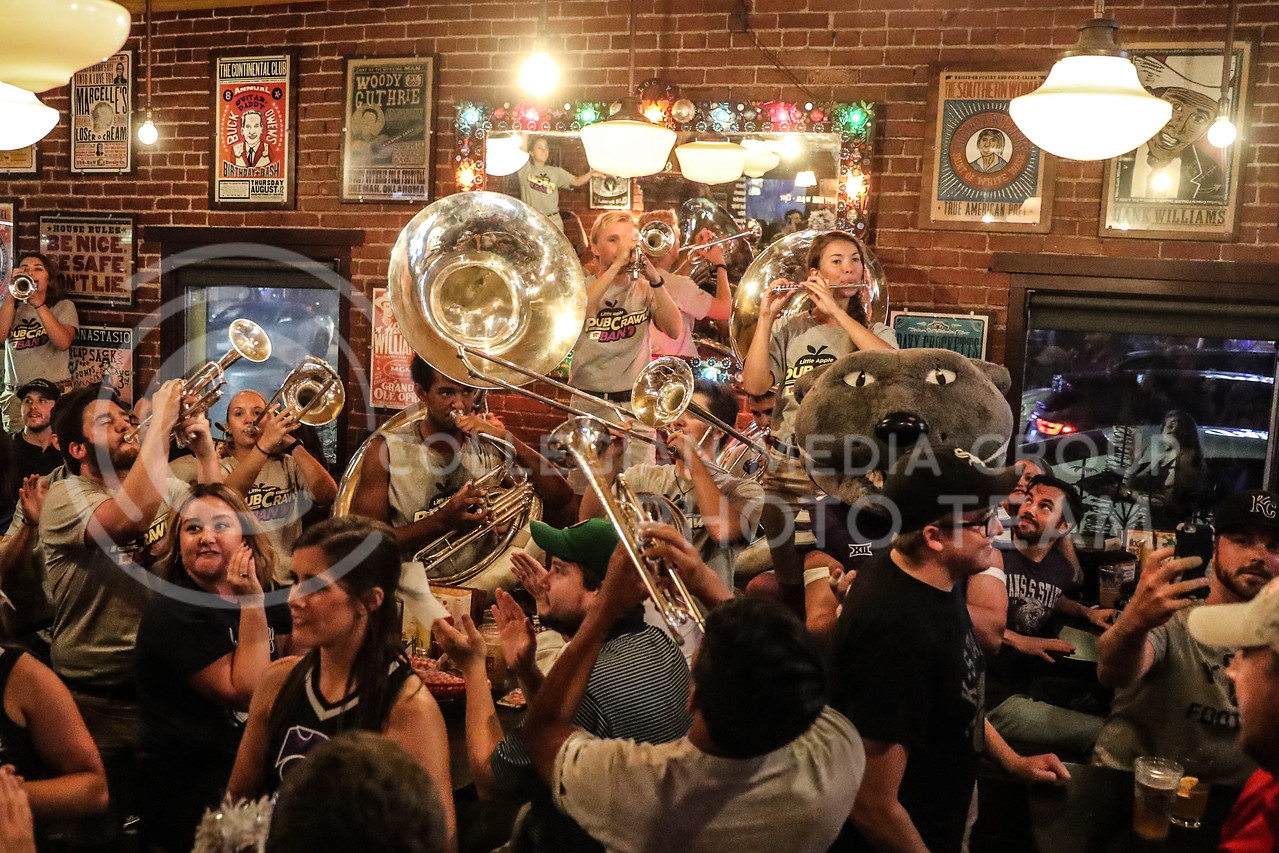 Members of the Pride of Wildcat Land perform at the So Long Saloon during a pub crawl on Friday, Oct. 20th, 2017 - one day prior to the KSU v.s. OU football game. (Photo by Cooper Kinley | Collegian Media Group)