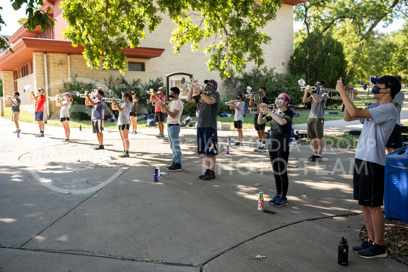 The Kansas State University, Marching Band, rehearses outside on campus with instrument coverings and face masks. August 27, 2020. (Dylan Connell | Collegian Media Group)