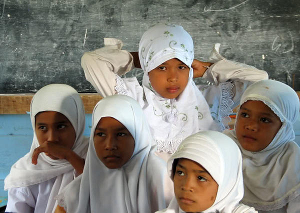 The visual itself. Seeing all these little girls with their white jilbabs … stunning. I took nearly 400 pictures that day. I was snap happy. Their little dark faces, with brown eyes surrounded by white lace, I was sure I probably will never see anything like this again.