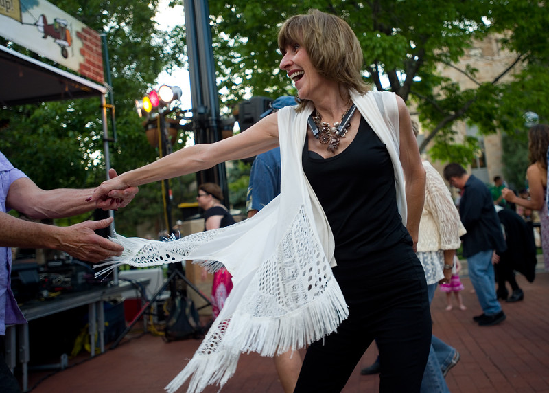 "Debra Holliway dances with Joel Thompson while Euforquestra performs at Boulder's Bands on the Bricks at Pearl Street Mall on Wednesday.<br /> More photos:  <a href=""http://www.dailycamera.com"">http://www.dailycamera.com</a><br /> Autumn Parry/Staff Photographer<br /> June 1, 2016"