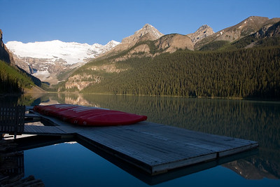 A very calm Lake Louise from the canoe deck in early morning. Took this picture before heading up the hillside towards Agnes Lake and Little Bee Hive.