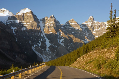 The road to Moraine Lake. If you wake up early enough, you can stand in the middle of this road to take a picture of the alpine scenery without getting mowed down by one of the millions of RV's that make the trip daily.