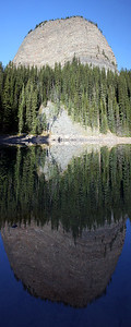 A panoramic taken at Mirror Lake with Big Beehive reflecting in the water.