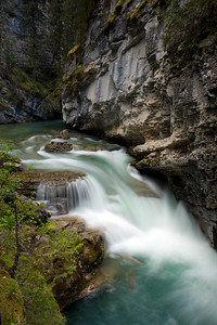 "Johnston Canyon was never on the ""to do"" list....but it's always those places where you have low or no expectations that seem to stand out the most. We went for a drive in the late afternoon along the Bow River Valley Parkway, and decided to stop off and do the quick 1km hike up Johnston Canyon to see the lower falls. It was a perfect time to go...no crowds and perfect waterfall lighting. This picture was taken about half way up the hike. We had a great time and would highly recommend seeing this area after 7pm in the Summertime. The path is in great shape, and we were able to get the stroller all the way up to Lower Falls so that Alex could see the falls (he loved them)."