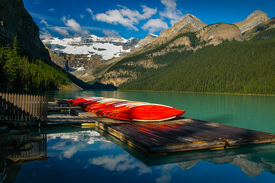 Canoes at sunrise await the day's activities in Lake Louise, located in Banff National Park of Canada near Calgary, Alberta