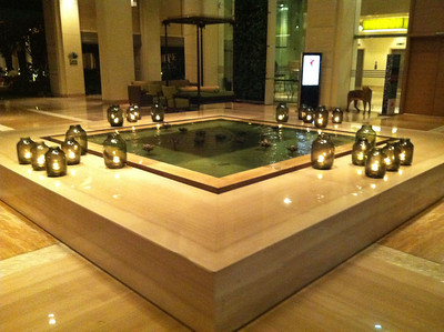 "Fountain in the foyer of the hotel in ""evening mode"" - no splash but we've got candles in jars."
