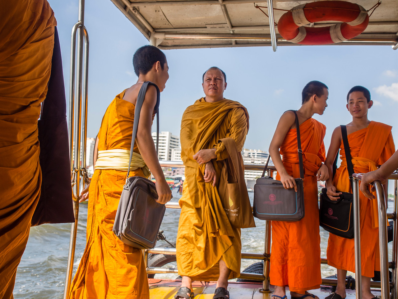 Monks on the Chao Phraya Express Boat, Bangkok, Thailand