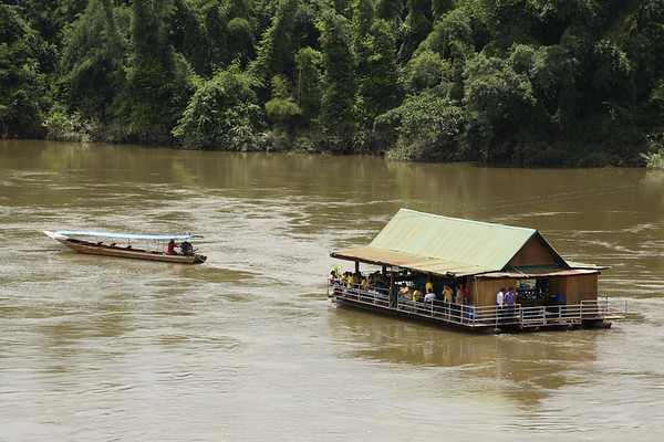 Relaxing dining aboard the floating restaurant right next to the Death Railway.