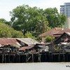 Hovels on the banks of the Chao Praya River in Bangkok, Thailand in June 2016