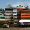 Interesting buildings on the banks of  the Chao Praya River in Bangkok, Thailand in June 2016