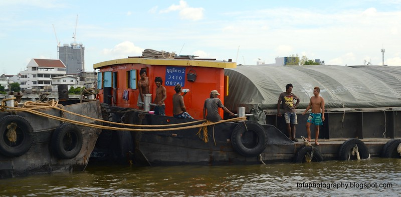 Crew of a coal barge on the Chao Praya River in Bangkok, Thailand in June 2016