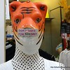 A mannequin covered with a tiger mask and a sign that says Don't touch, fine 200 baht. Seen outside a shop at the Pratunam shopping mall in Bangkok, Thailand in August 2017