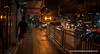 Man walking down a street at night in Silom, Bangkok, Thailand, in December 2009