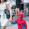 Boy in a spider man suit with his mother in Silom, Bangkok, in December 2009