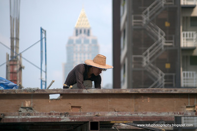 Construction worker in Bangkok, Thailand in December 2009. I took this from the 8th floor of the hotel