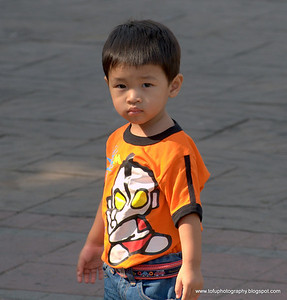 Boy in Lumphini Park, Bangkok, Thailand, December 2009