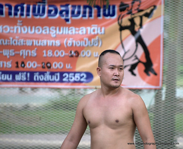 Man playing volleyball in a park near the Chao Praya River in Bangkok, Thailand in December 2009
