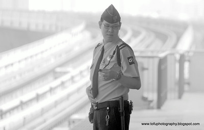 Security guard taken at Silom BTS station, Bangkok, Thailand, in December 2009