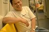Man on the skytrain in Silom, Bangkok, Thailand, in December 2009. His shirt says whore!