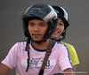 Couple on a motorbike by the Chao Praya River opposite the Saphan Thaksin BTS station, Bangkok, taken in December 2009
