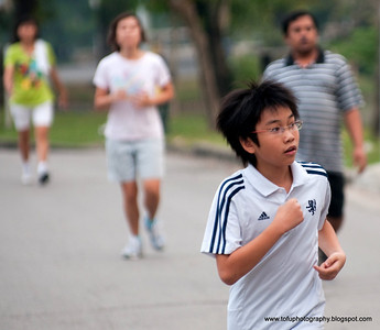 Boy running in Lumphini Park, Bangkok, Thailand, in December 2009